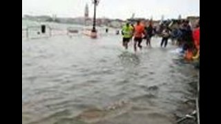 Venice Marathon Runners Run Through Flooded Street
