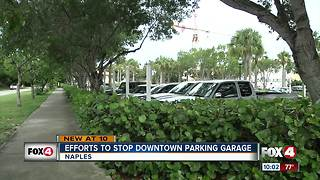 Opponents try to drive away parking garage - Video