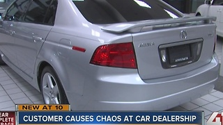 Customer causes chaos at car dealership - Video