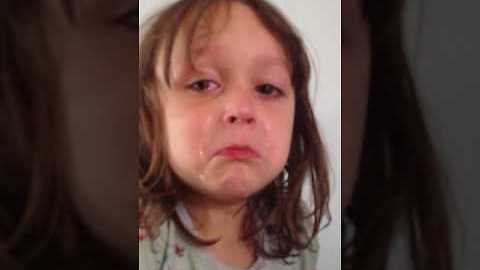Emotional little girl cries during 'Dumbo' sad scene
