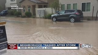 Neighbors blame design for road flooding - Video