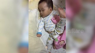 Adorable Toddler Sleeps With His Leg Up