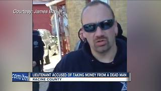 Racine officer accused of stealing money from dead man - Video
