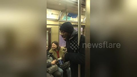 Busker brightens New York commuters' day with rousing rendition of 'Lean on Me'