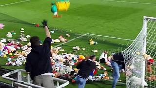 Charleroi fans throw cuddly toys onto pitch for underprivileged children - Video