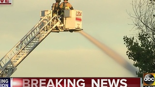 Firefighters battling flames in Gilbert - Video