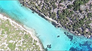 "Drone footage captures incredible ""blue lake"" of Greece"