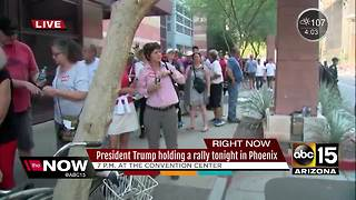 Protesters, supporters scuffle ahead of President Trump's rally - Video