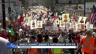 Hundreds march against sheriff's partnership with ICE - Video