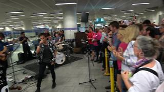 Jamie Cullum puts jazz slant on 'C'mon England!' chant as he surprises commuters with set at King's Cross station