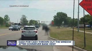 Bank robbery in Taylor leads to money flying in the streets - Video