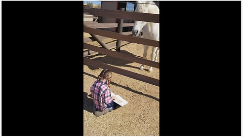 Horse Is Captivated By A Little Girl Reading To Him
