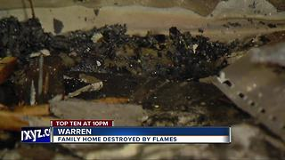 Family of six displaced after fire rips through Warren home - Video