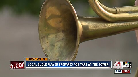 Local bugle player prepares for Taps at the Tower