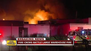 Firefighters battle large warehouse fire in Dover - Video