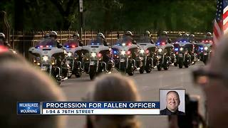 Sirens sound as funeral procession for fallen officer reaches cemetery