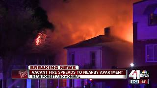 Fire in abandoned building spread, displacing at least 3 people