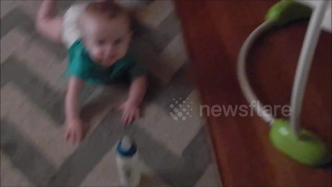 Lazy baby refuses to crawl to grab bottle