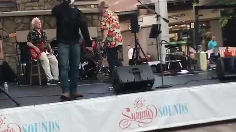 Man in mask jumps on stage during Partridge Creek concert in Shelby Township