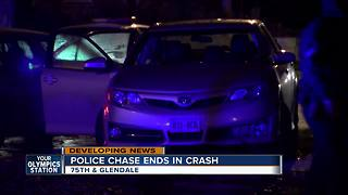 Police pursuit ends in crash, arrests - Video