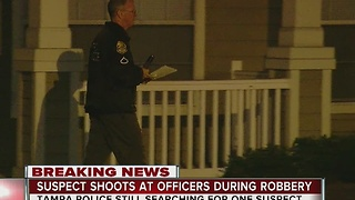 Suspect shoots at officers during robbery - Video