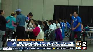 150 local organizations and 2,000 volunteers aid the homeless at Baltimore Convention Center - Video