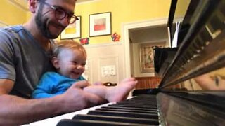Baby plays piano with his feet!