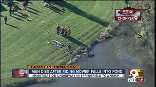 Man dies after riding mower falls into pond - Video