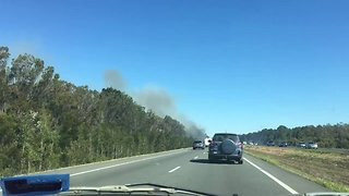 Bushfire's Heavy Smoke Reduces Visibility Along Bruce Highway - Video