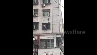 Good Samaritans rescue boy hanging from third-floor window - Video