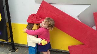 Little Girl Makes Friends With Lego Models At Legoland