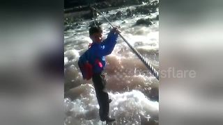 The children who cross rapids just to get to school - Video