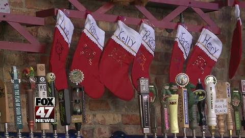Santas needed to have fun while giving back during SantaCon on Monday