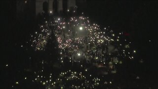 Denver protesters create light in darkness at the Colorado State Capitol to honor George Floyd