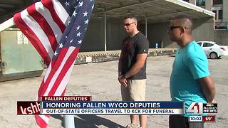 Officers travel to honor fallen WyCo deputies - Video