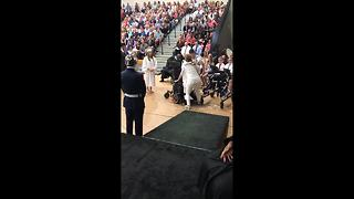 Woman born with cerebral palsy walks to stage during graduation ceremony