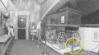 Paranormal investigator captures moment 'ghost' appears to lift handle of abandoned hearse