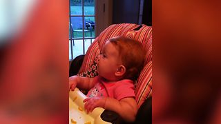 Baby Adorably Disagrees With Dad - Video