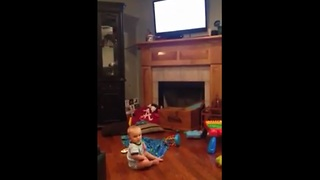 Baby looks at TV everytime mom says