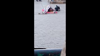 Young girl on street in Kenya shows off mind-bending contortion skills