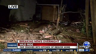Car crashes through 2 fences, into home in Denver