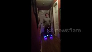 Boy on hoverboard crashes into Christmas tree - Video
