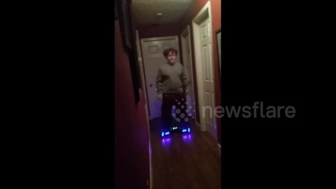Boy on hoverboard crashes into Christmas tree