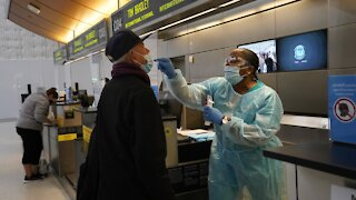 U.S. Health Officials Continue To Warn Against Holiday Travel