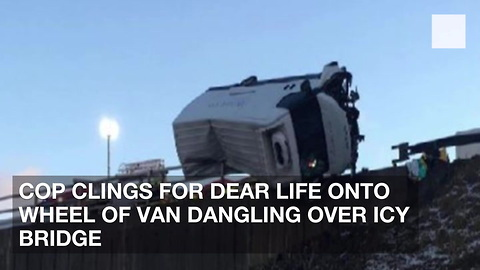 Cop Clings for Dear Life onto Wheel of Van Dangling Over Icy Bridge