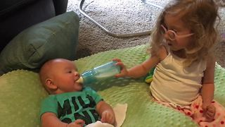 Big sister helps out her baby brother - Video