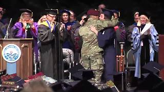 Army husband surprises wife on stage at Florida Atlantic University graduation - Video