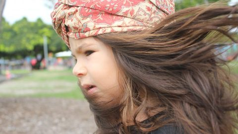 Big hair baby! Two-year-old dubbed mini-Rapunzel due to lusciously long locks that flow past her shoulders starts modelling thanks to massive mane