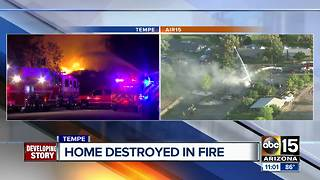 Home destroyed after stubborn fire in Tempe - Video