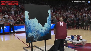 Man Paints Amazing Picture While SInging National Anthem - Video
